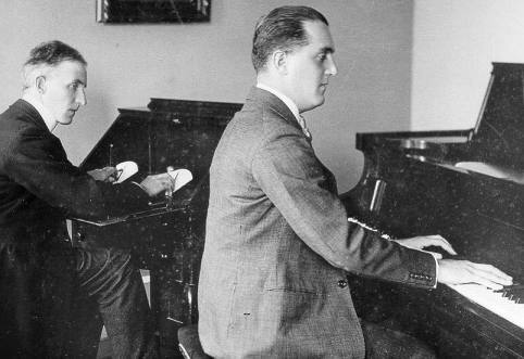 Max Darewski recording a Duo-Art roll in London circa 1921 with Reginald Reynolds at the recording console